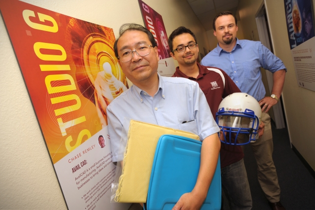 07/20/2015: Left to right: Mechanical engineering Research Associate Professor Roy L. Xu, chemical engineering graduate student Brian Patterson, and Studio G Director Dr. Kramer Winingham are using a $50,000 award from the National Science Foundation's Innovation Corps program to further develop a protective shield material that can help save lives. (Photo by Darren Phillips)